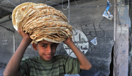 Syria boy with bread AFP
