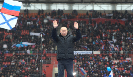 Russian Prime Minister Vladimir Putin gestures as he attends a massive rally in support of him at Luzhniki stadium in Moscow,  Russia, Thursday, Feb. 23, 2012. Tens of thousands of people marched along the Moscow River and then packed a soccer stadium on Thursday for a campaign rally in support of  Putin. Many of them appeared to be state employees who attended at the behest of their employers.(AP Photo/RIA Novosti, Yana Lapikova, Government Press Service)
