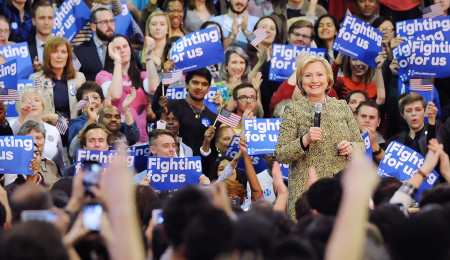Rebecca Droke/Post-Gazette--Wednesday, April 6, 2016-- The crowd cheers as Democratic presidential candidate Hillary Clinton calls for equal pay for equal work during a rally at Skibo Gymnasium at Carnegie Mellon University on Wednesday, April 6, 2016.